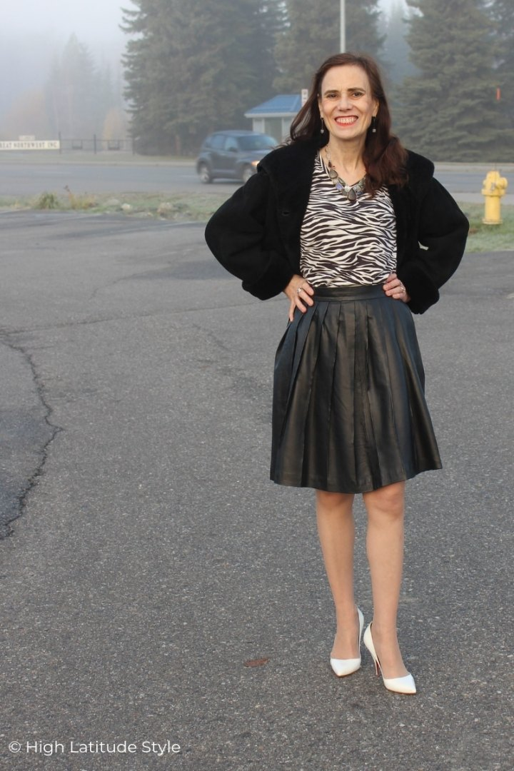 over 50 years old style blogger in zebra top, pleated skirt and cropped jacket