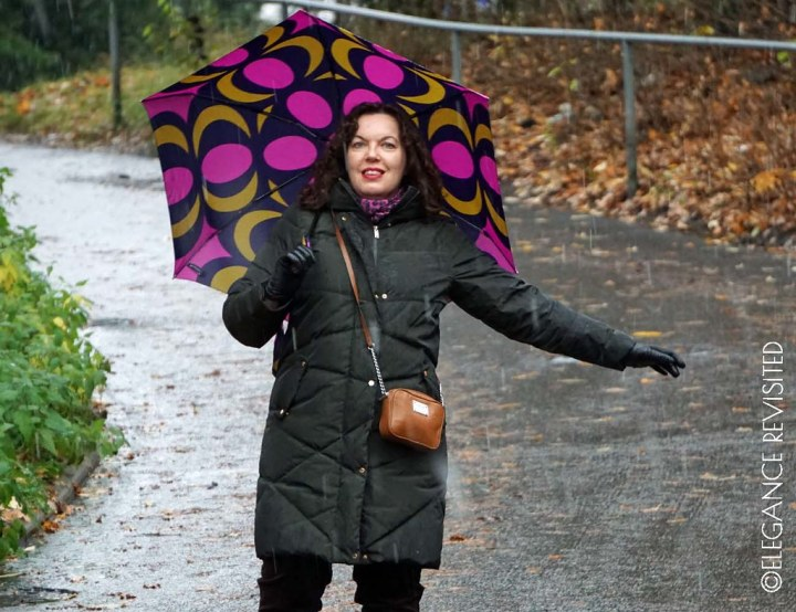 Top of the World Style Winner Tiina with downcoat and umbrella