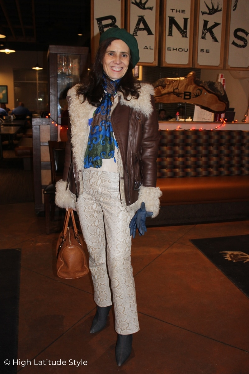 style blogger in all neutral colors winter look with snake-print pants,
