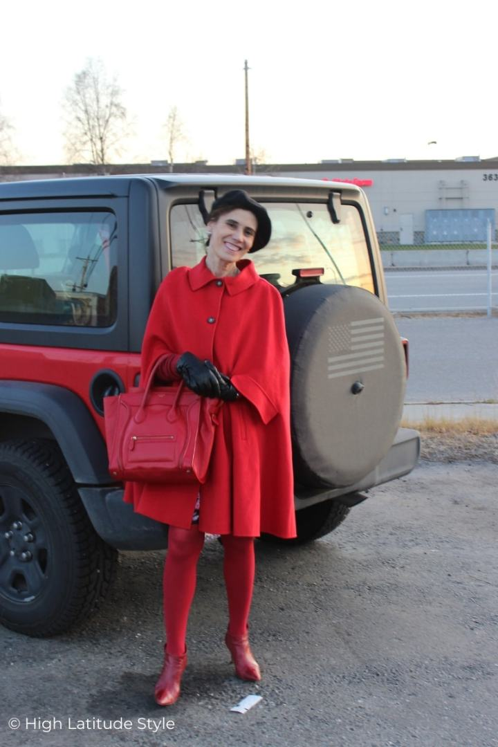 Stylist in monochromatic red cape, tights, bag, shoes lotd