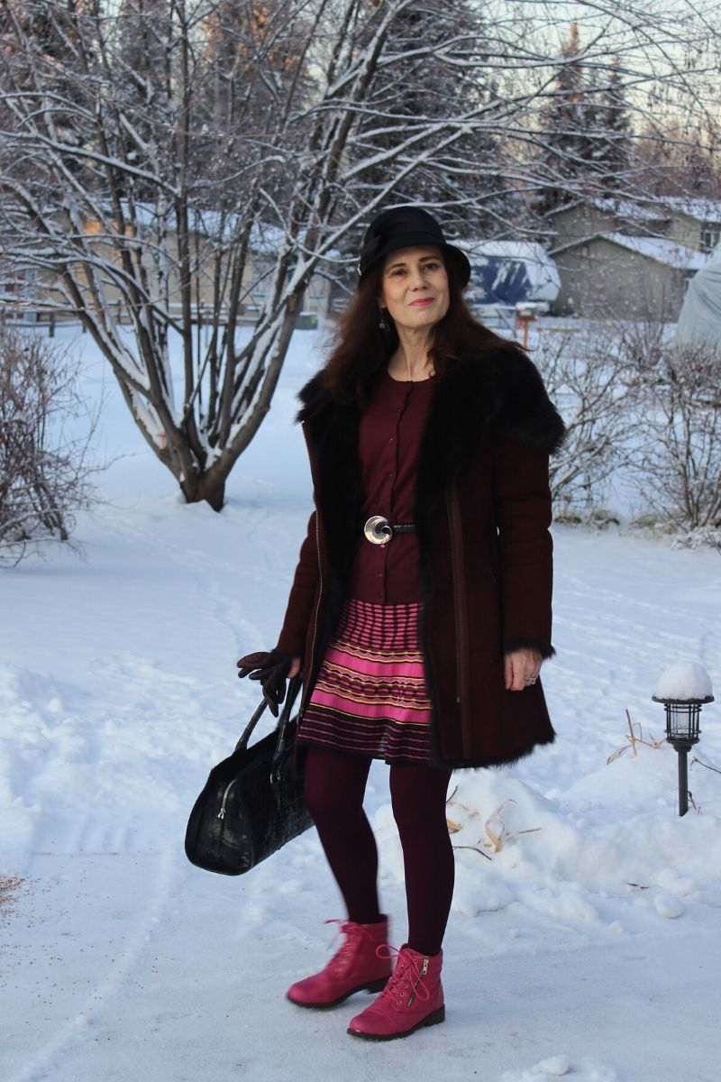 Alaskan blogger with striped dress, burgundy cardigan, tights, gloves and shearling and pink shoes