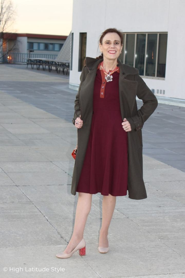 fashion blogger in open coat with dress and heels
