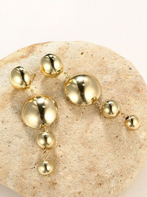 Just Fashion Now round golden earrings