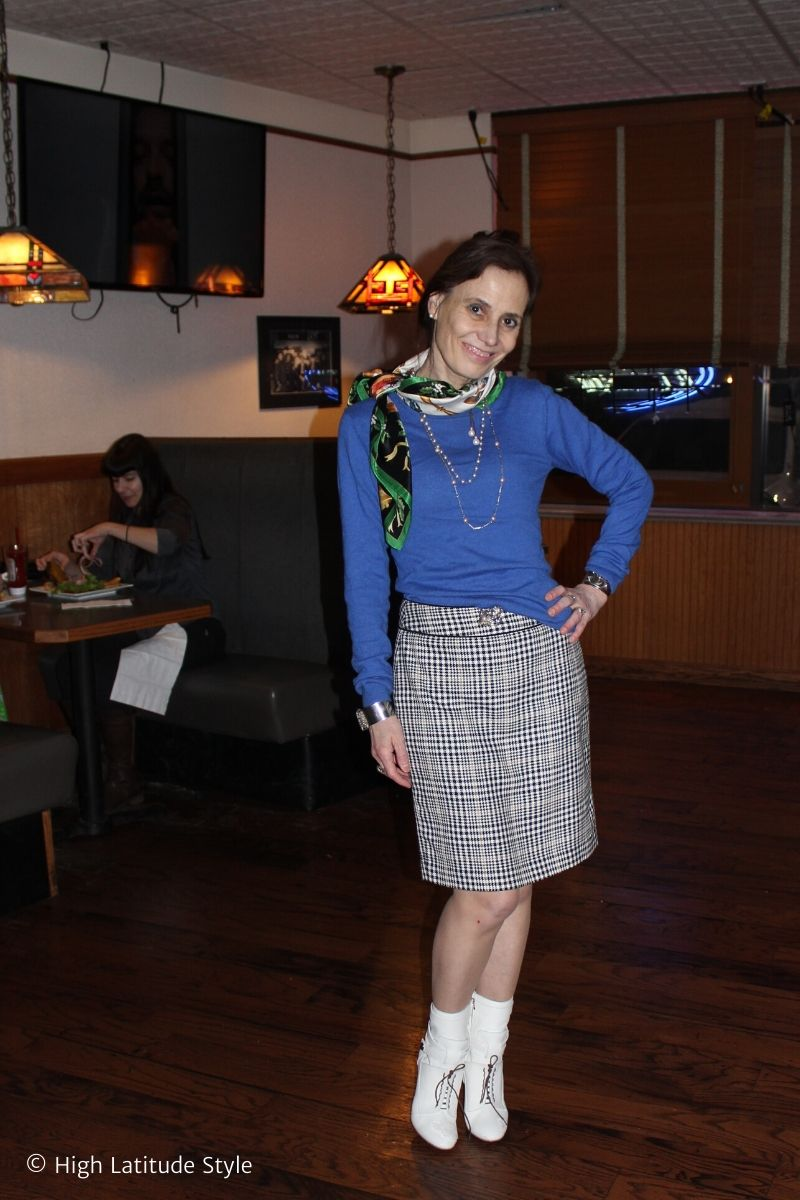 over 50 years old Alaskan fashion blogger in blue sweater with hounds tooth skirt and white booties