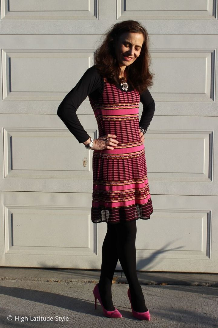 fashion blogger in striped dress styled as a jumper with layering top, tights and pink pumps