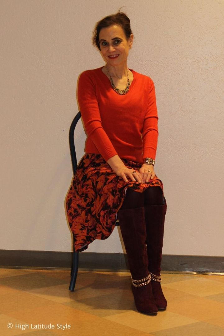 over 50 years old fashion blogger in orange sweater with floral skirt outfit