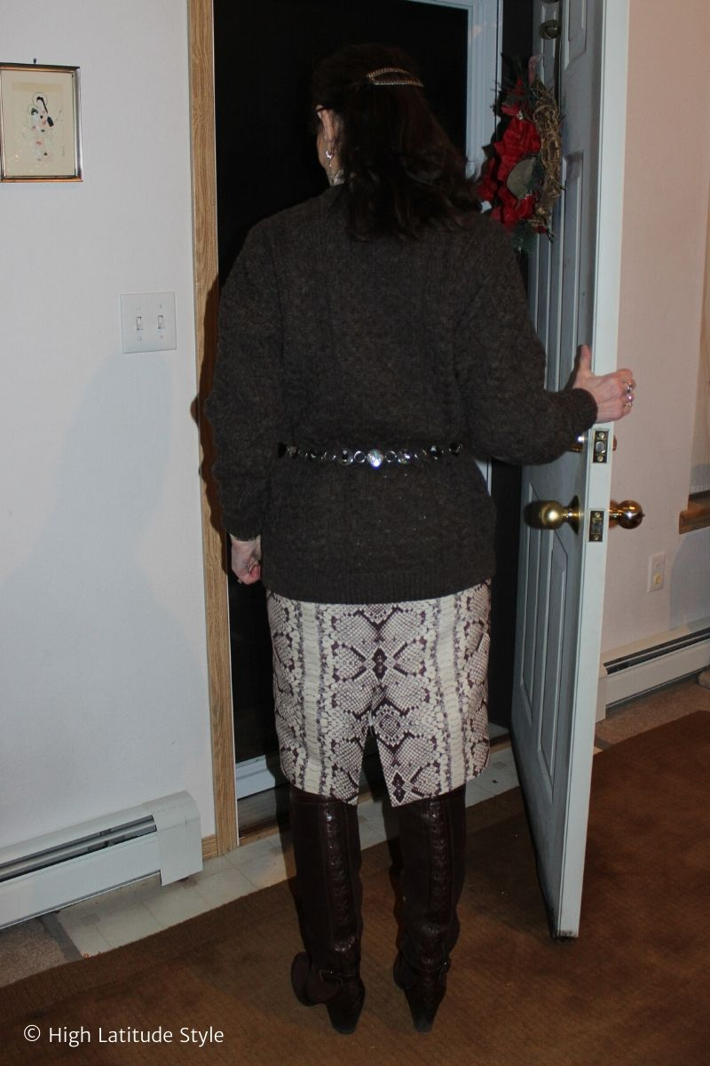 blogger with barrette, ethnic belt, Irish cable knit sweater, snake print skirt, over-the-knee boots