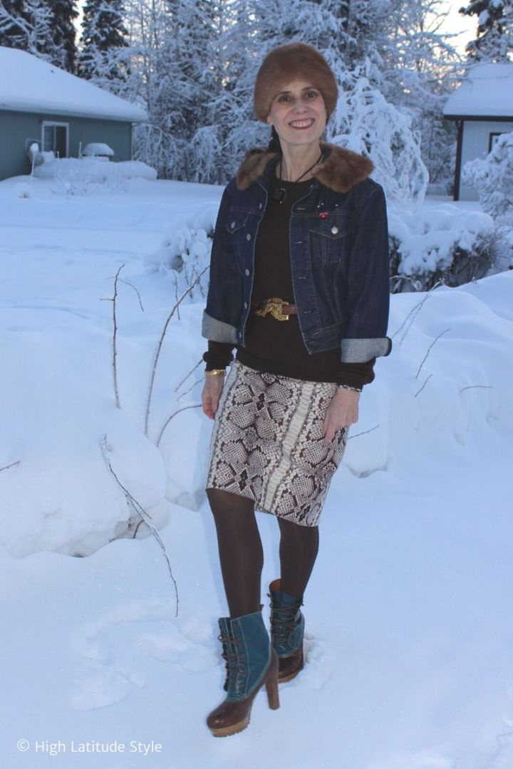 Nicole in snake print skirt, jeans jacket, sweater, hat, heeled ducks and belt