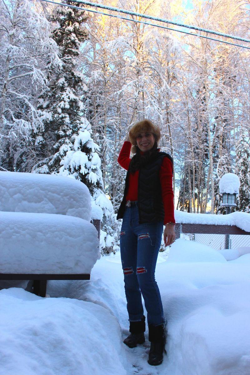 Alaskan stylist in jeans, vest, turtleneck sweater headband and booties