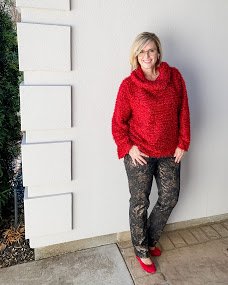 Andrea Schwartz in camo pants and ruby shoes and sweater