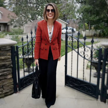 Suzanne Bell in roast double-breasted blazer and black pants