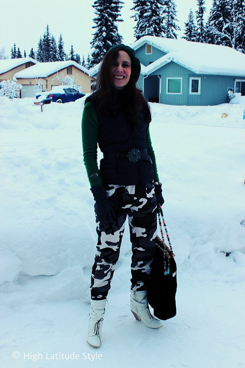 Alaskan woman in Arctic camouflage paperbag pants, vest, turtleneck and gloves