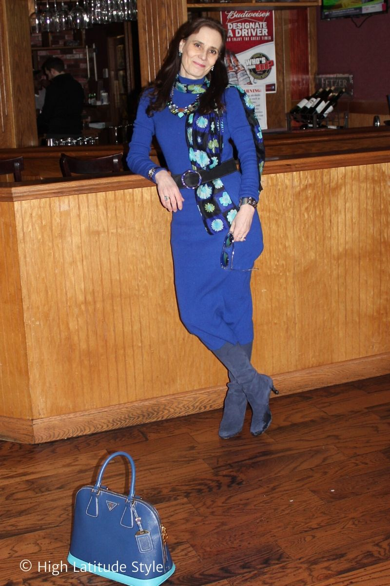 fashion blogger in monochromatic blue look with sunglasses and floral scarf