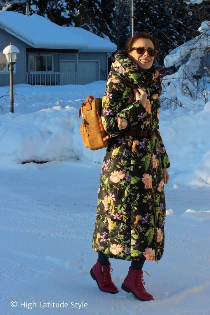 Alaskan in floral down coat with backpack and sneakers