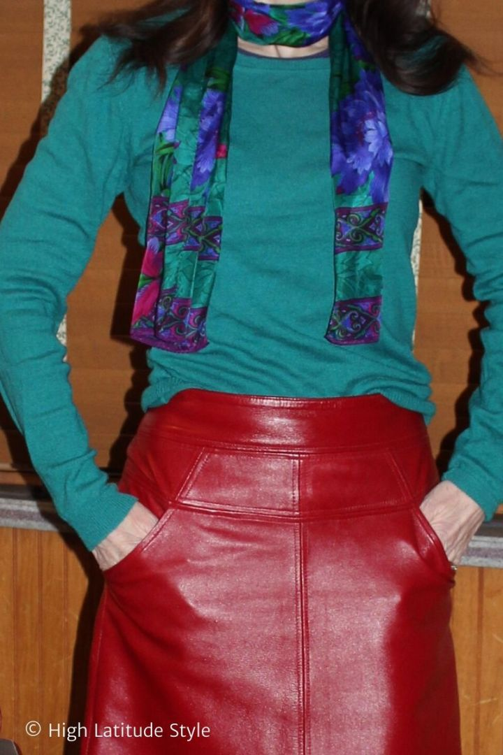 details of foral and geometric print scarf, sweater and cherry red leather skirt