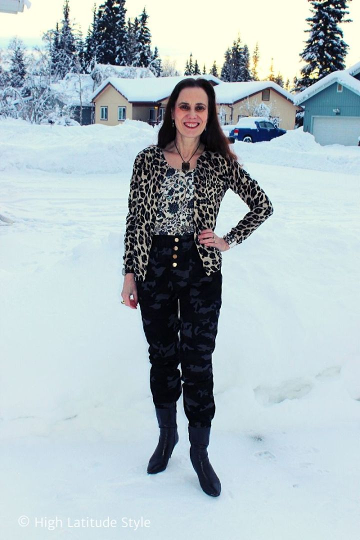 midlife blogger in floral top, leopard cardigan camo Femme Luxe pants and booties