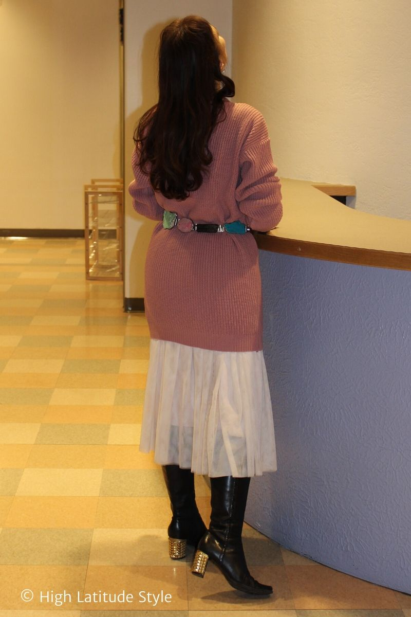 over 50 years old fashion blogger in knit dress over tulle skirt with tall boots