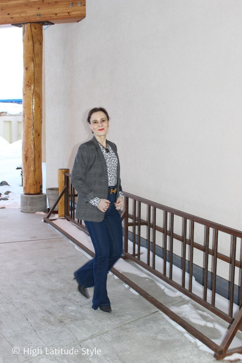 Alaskan blogger in winter business casual top, blazer, flared jeans, booties