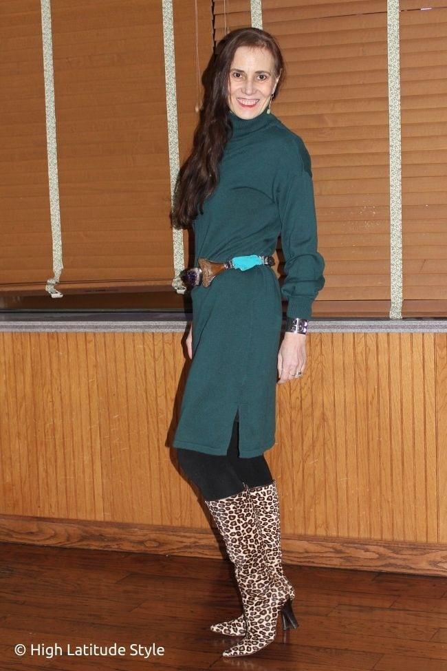 fashion blogger in below the knee sweater, gemstone belt, leopard print boots, black tights