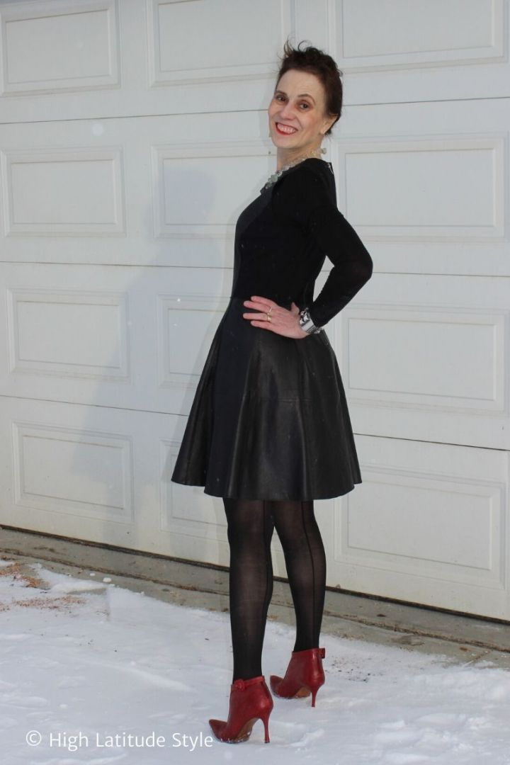 stylisblack leather dress, red booties, sheer Sheertex pantyhose with back seam t in