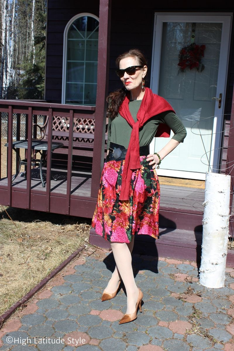 style book author showing a floral skirt outfit idea with top and accessories
