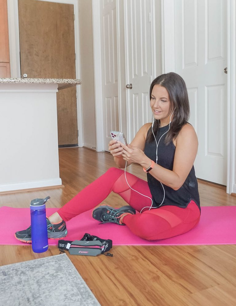 Karen Kocich in red mesh workout leggings and black tank top plus sneakers