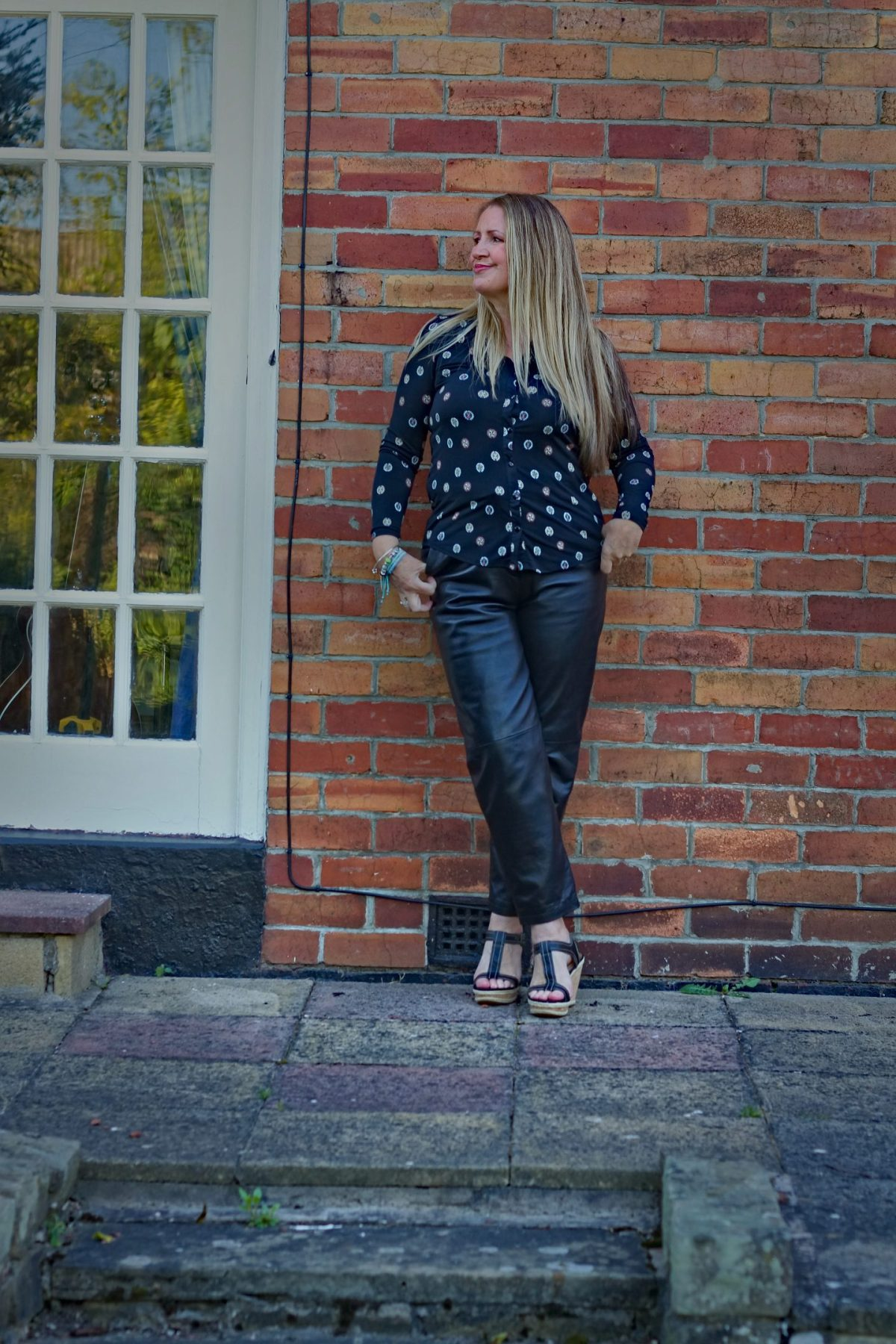 Alison of Midlife and Beyond in leather trousers and floral shirt