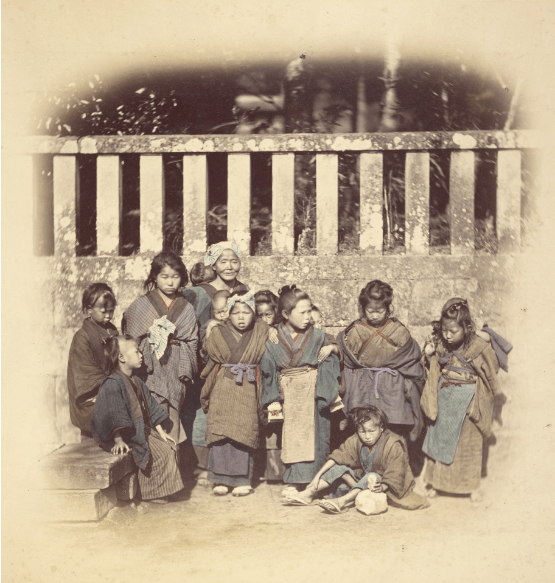 Old women and children in traditional Japanese attire in the Meiji era