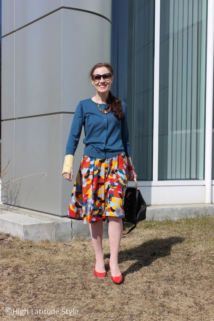 Stylist Nicole walking on a lawn in spring outfit