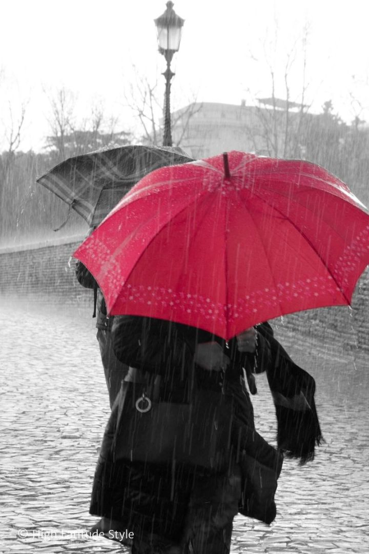 people on gray rainy day with red mood upping umbrella