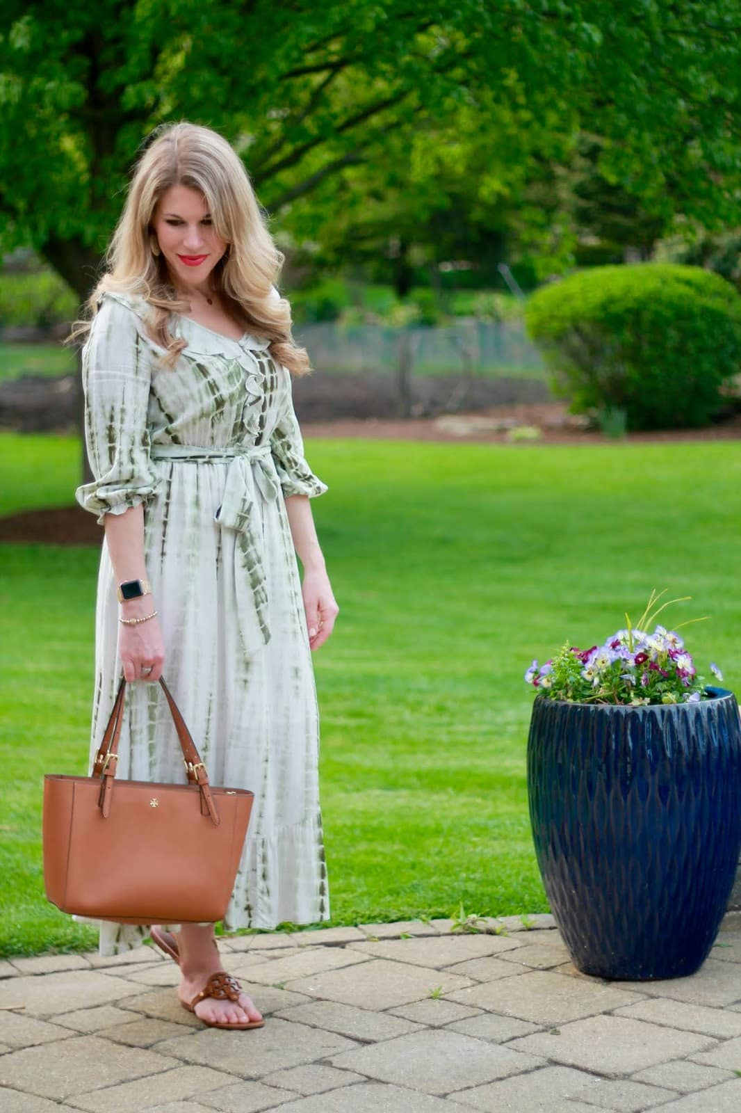 mom blogger Laura in romantic green tie dye white maxi dress