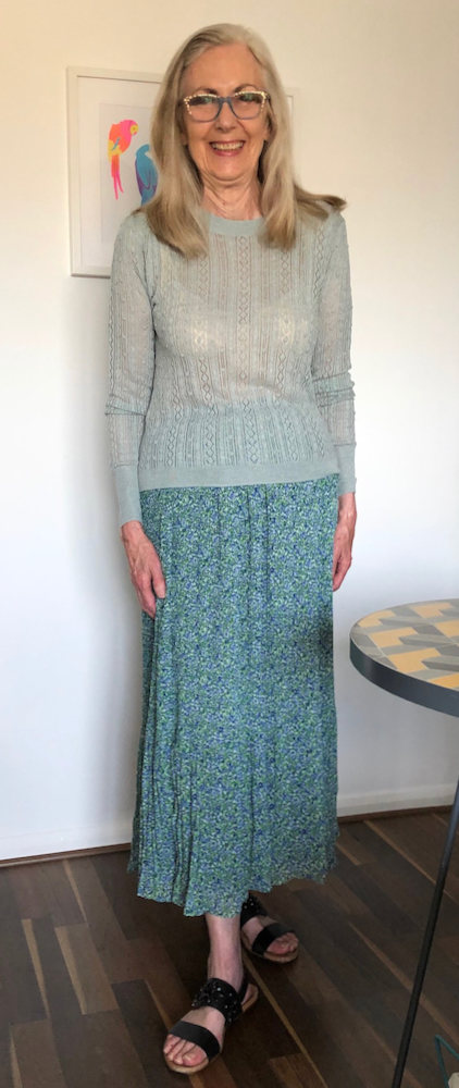Penny Kocher in whimsical fleur print maxi skirt and lace knit sweater