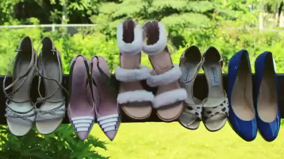 pretty shoes hanging on a railing