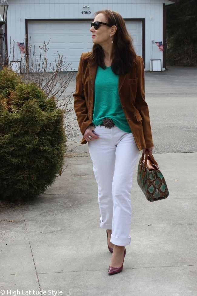 style influencer in menswear inspired suede blazer, jeans and tee outfit with sunglasses