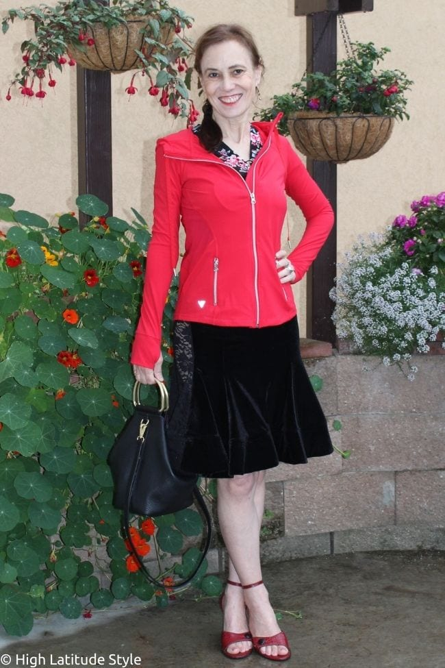 style blogger in red hoodie and dance dress