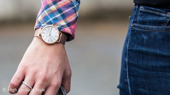 classic large dial golden watch and diamond band with practical jeans and plaid shirt