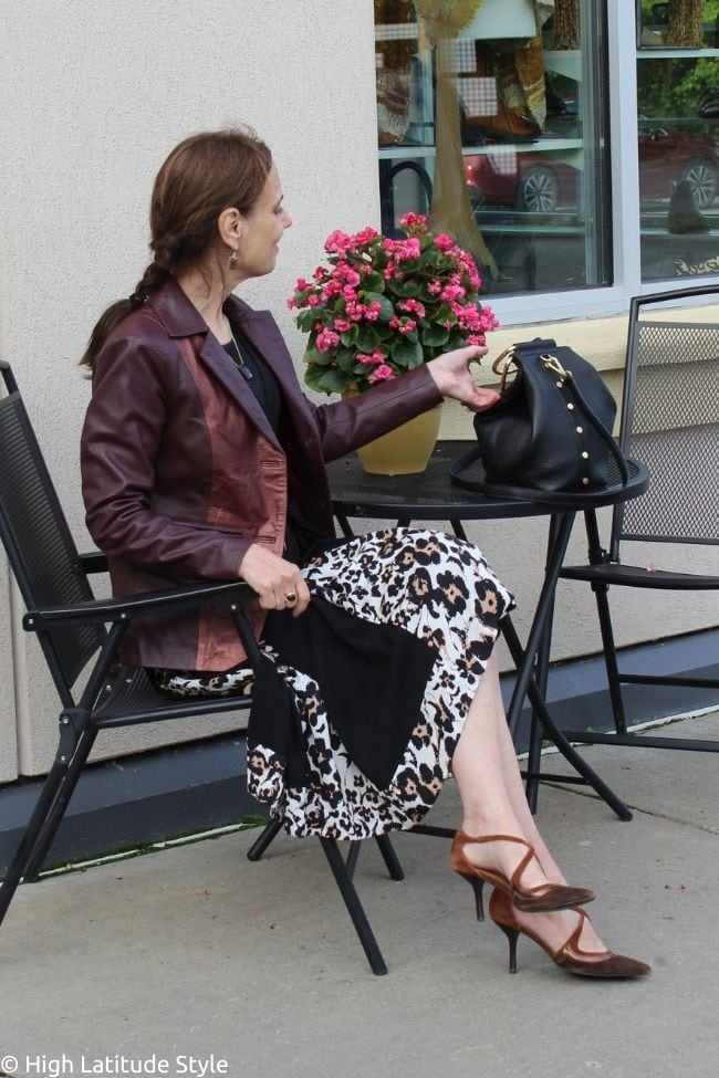 influencer in fall wardrobe of leather jacket and leopard print dress