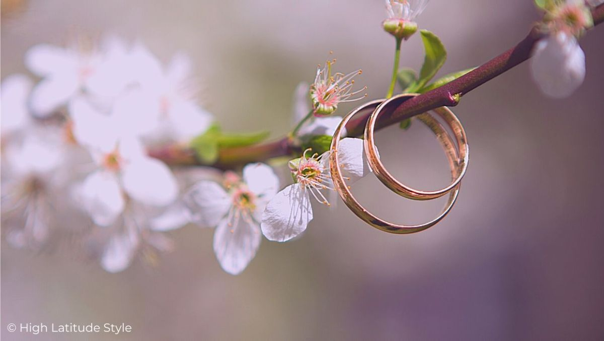 engraved wedding bands on a cherry blossomed twig