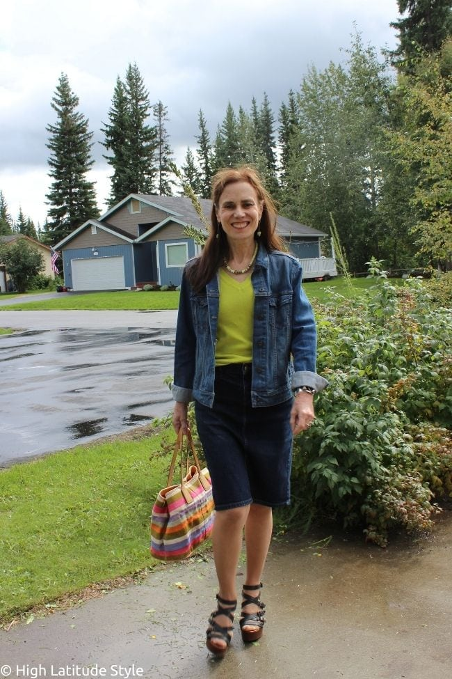 fashion blogger in fall denim skirt and jacket ensemble