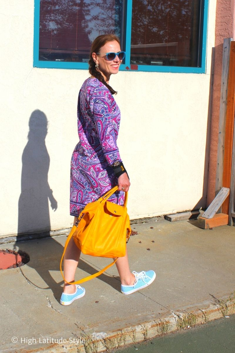 fashion blogger in pink, purple, blue dress, matching sneakers and pliage