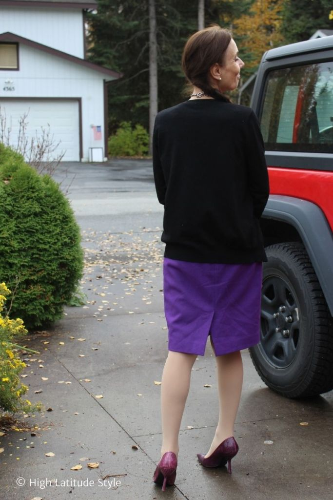 back view of outfit with nude panties, purple skirt and pumps, black cardigan