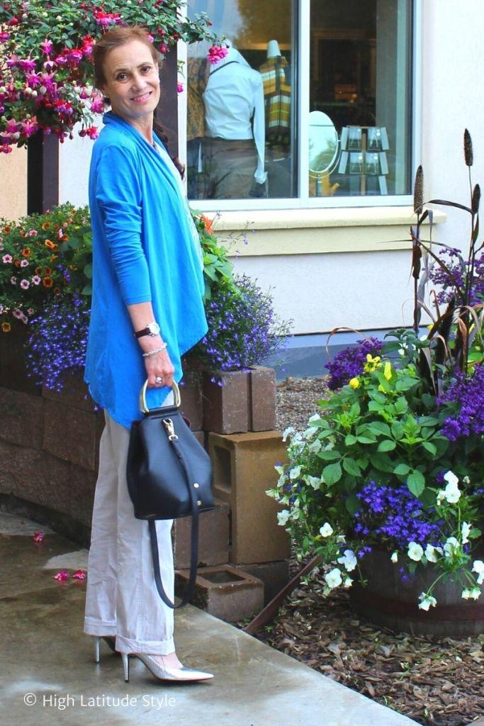 stylist in gray summer pants, blue jacket
