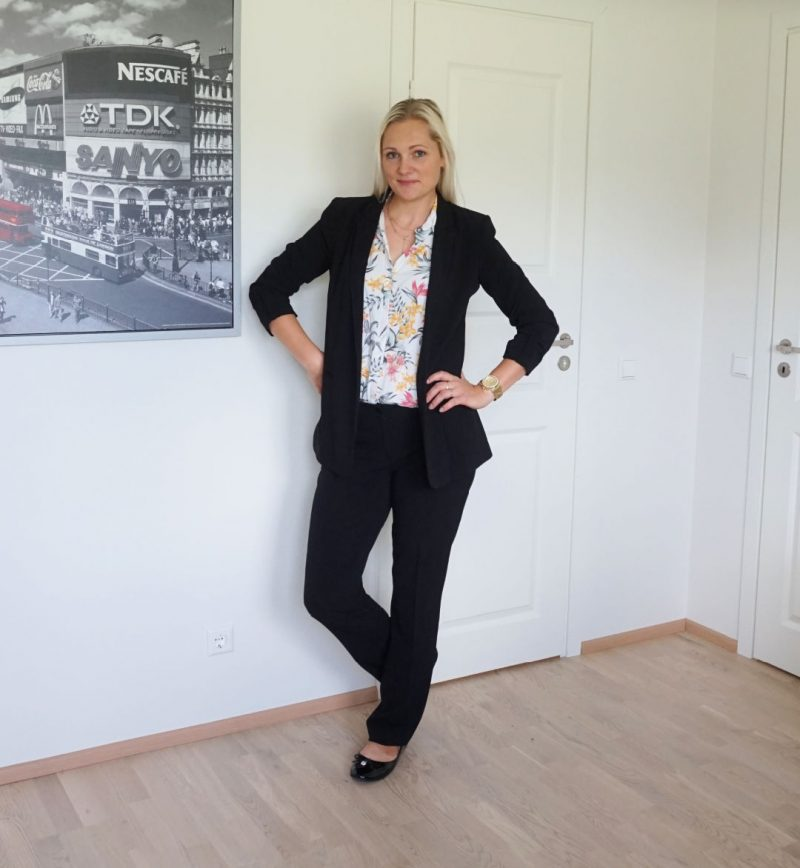 Leelo from Beauty by Miss L in black pantsuits and floral top