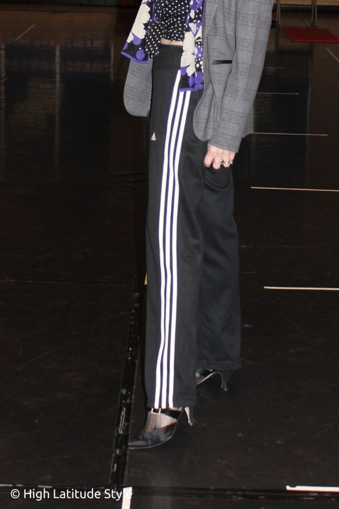 zoom in on the three stripes of the pants that look like casual tux pants