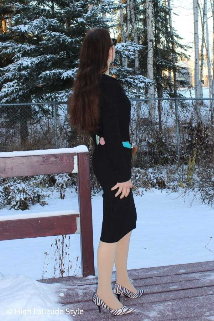 style blogger in LBD with hand-made belt looking into a winter yard