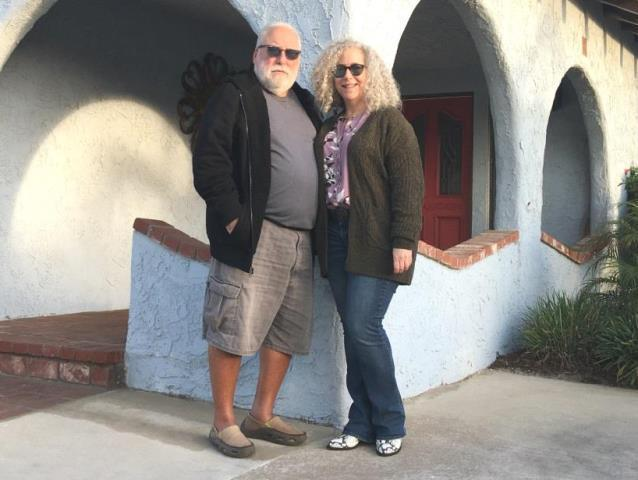senior couple in California casual outfits