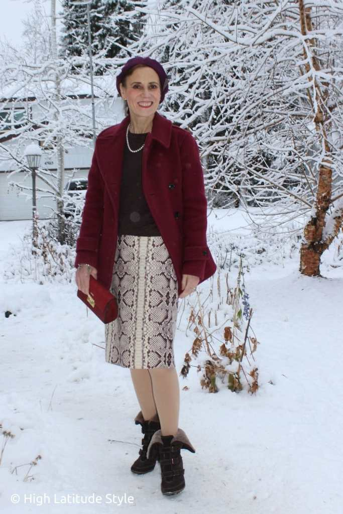 style book author in snake print bottom, peacoat, sweater
