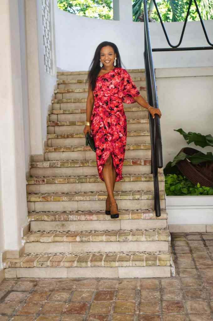 Iris of La Mamous in red floral dress