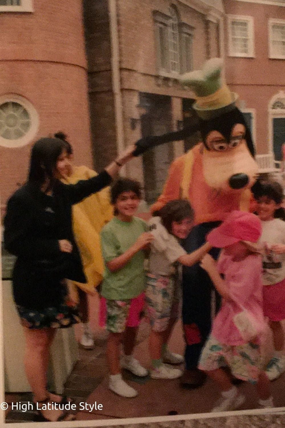 young woman pulling Goofy's ear in Disney Park Orlando