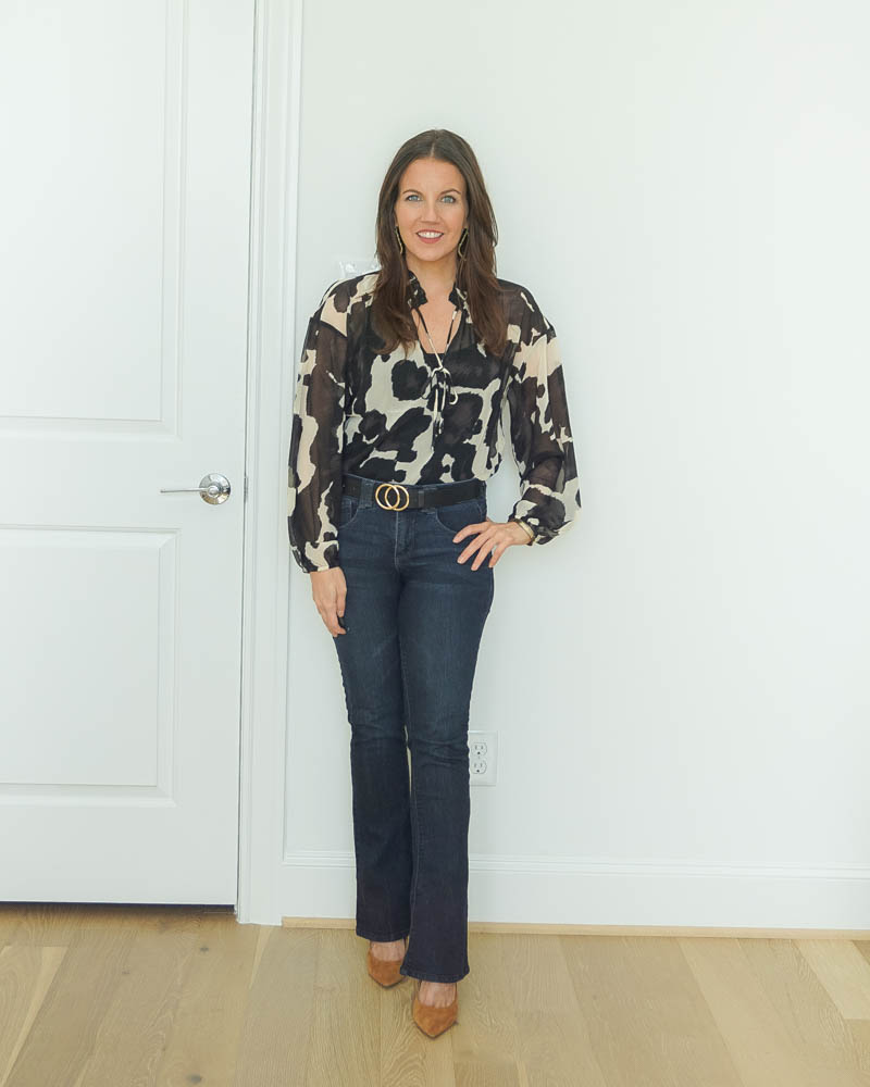 Karen from Lady in Violet wearing a cow print top with jeans and pumps